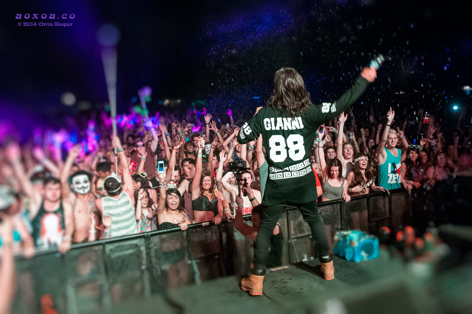 DVBBS's Alex slings water into the audience.